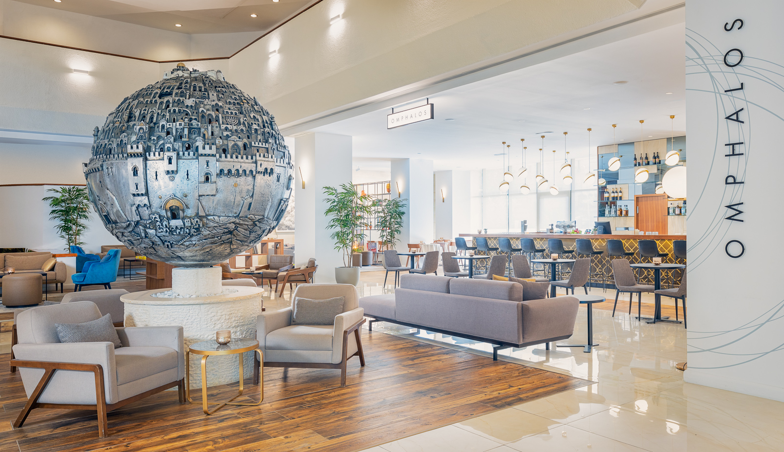 Lobby of the King Solomon Hotel, Jerusalem, with a giant silver globe of Jerusalem in the center of the lobby