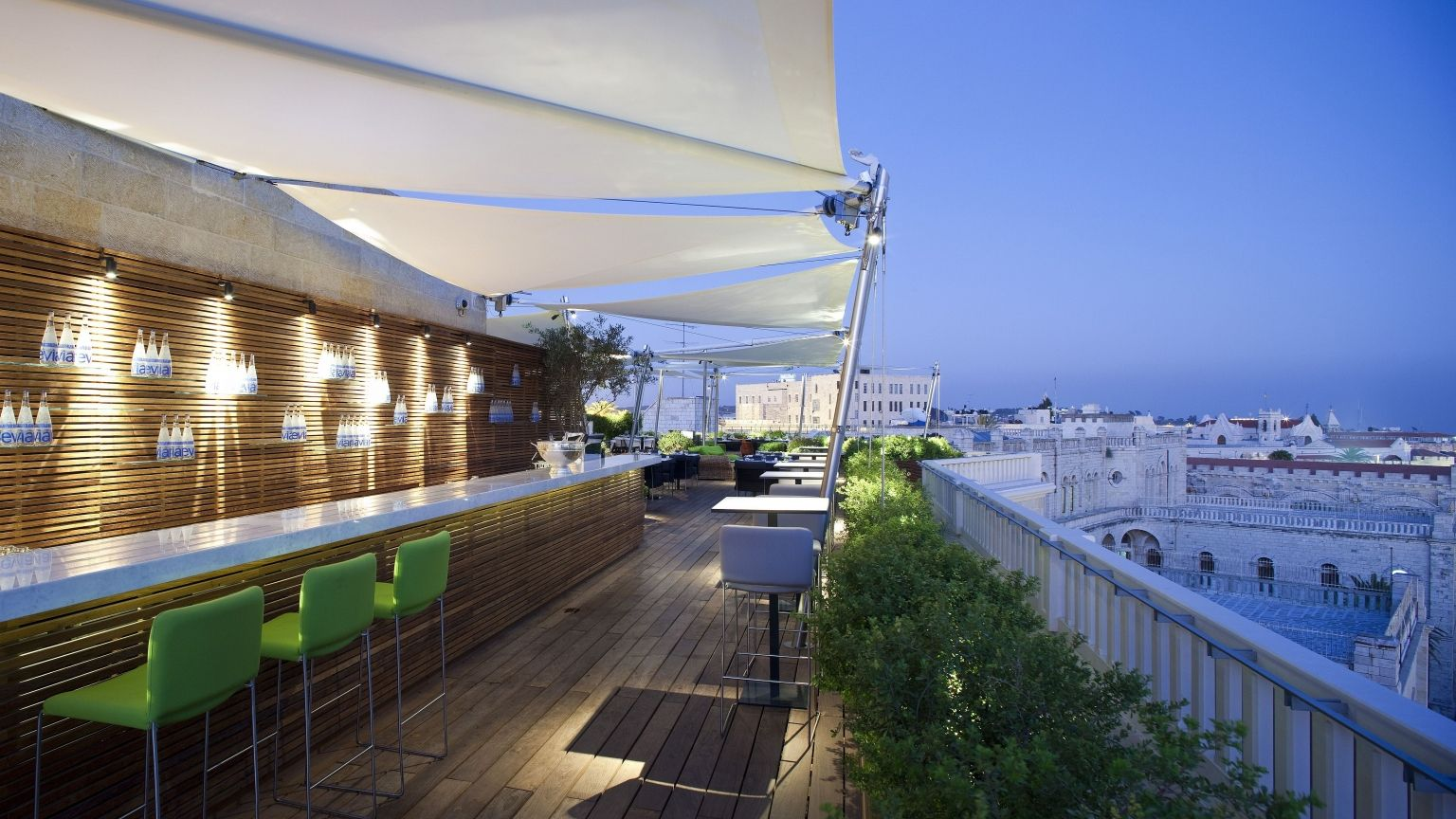 Mamilla Hotel's rooftop restaurant deck and city view at night
