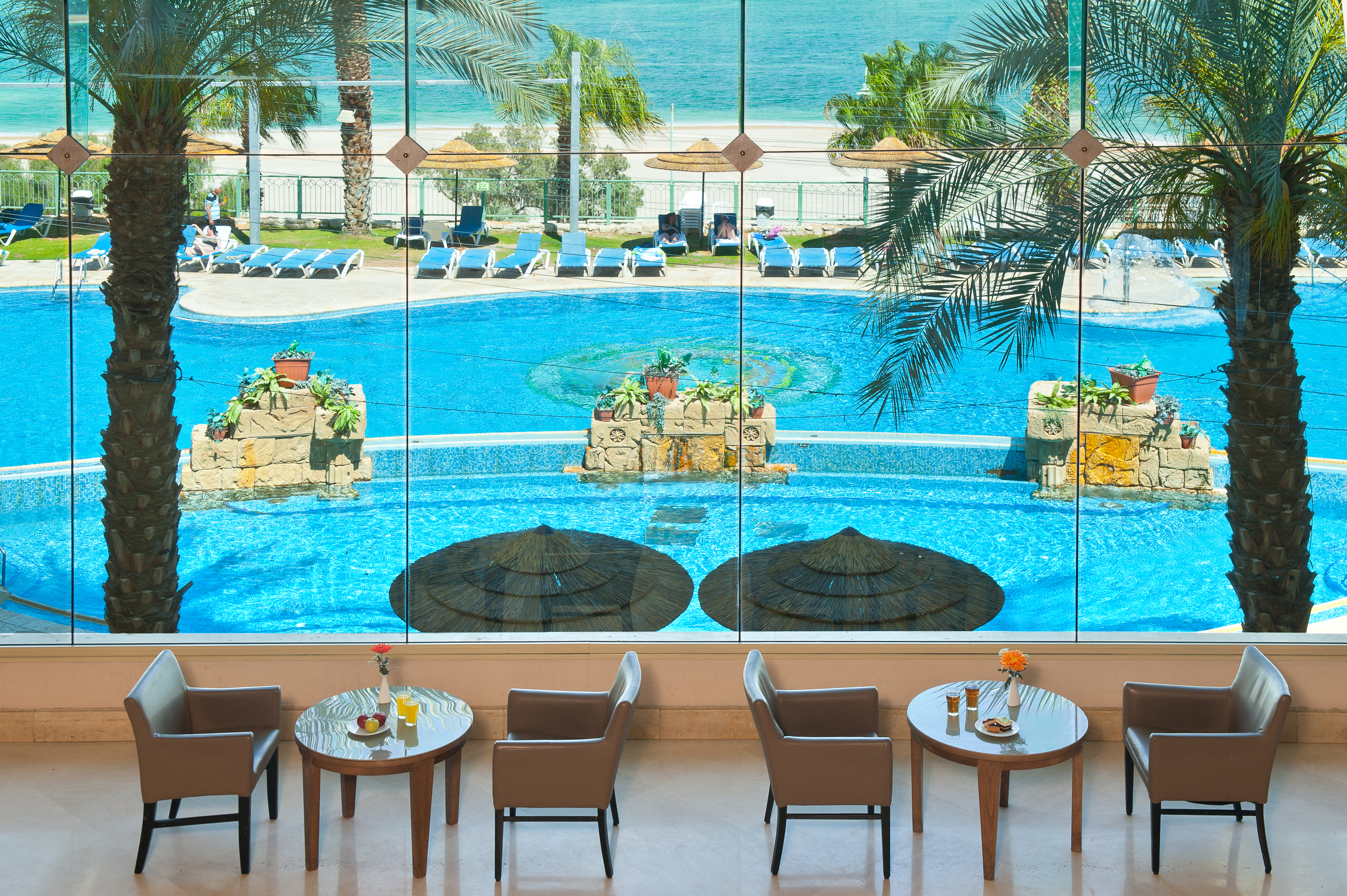 View of the pool and beach from the lobby