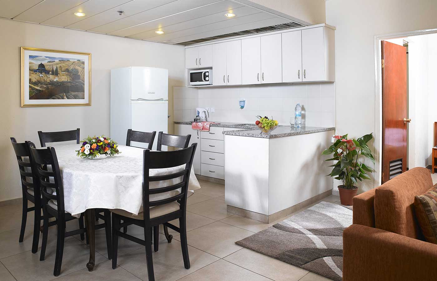 Suite in the hotel with kitchenette, sofa, table and chairs
